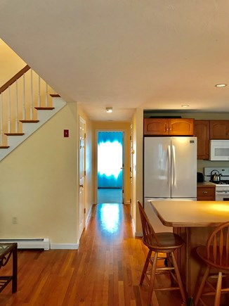 Mashpee, Popponesset Cape Cod vacation rental - Hallway to master bedroom, half bath on right