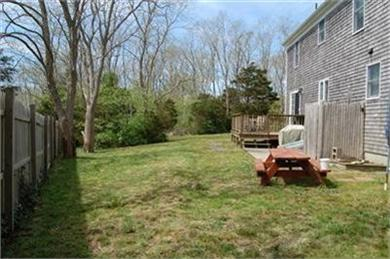 North Eastham Cape Cod vacation rental - Back has deck, picnic & patio tables, hammock & outdoor shower