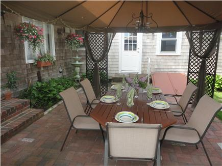 Hyannis Cape Cod vacation rental - Patio area with picnic table for six under canopy shade