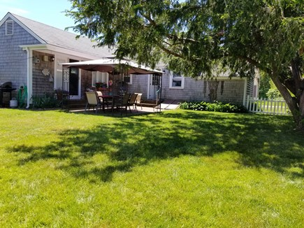 Hyannis Cape Cod vacation rental - Back yard all fenced in professional landscaping.