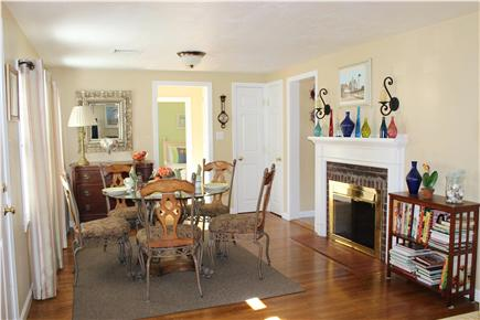 Hyannis Cape Cod vacation rental - Dining room area by the fireplace