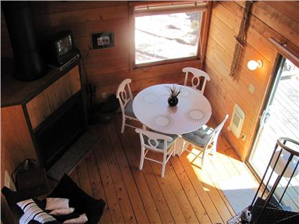 South Wellfleet Cape Cod vacation rental - View from loft. Cozy living room, fireplace and slider to deck.