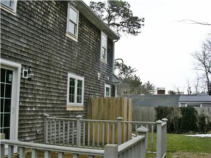 Dennis village Cape Cod vacation rental - Private back yard with built-in bench on deck