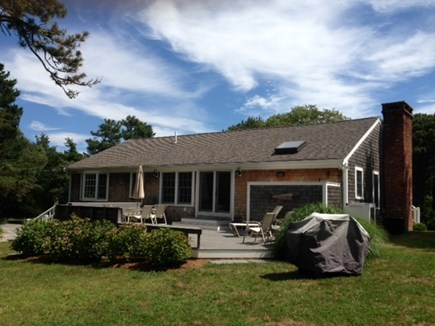 East Orleans Cape Cod vacation rental - Back of Home with Large Deck & Outdoor Shower