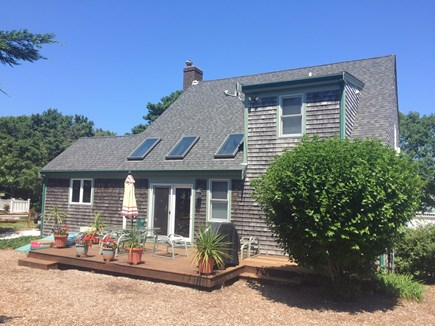 Brewster Cape Cod vacation rental - Back of Home with Deck, Outdoor Shower & Gas Grill
