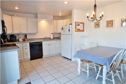 West Yarmouth Cape Cod vacation rental - Kitchen and dining area with entrance from new expanded deck