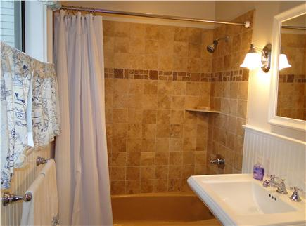 Brewster Cape Cod vacation rental - Master bathroom with shower and tub