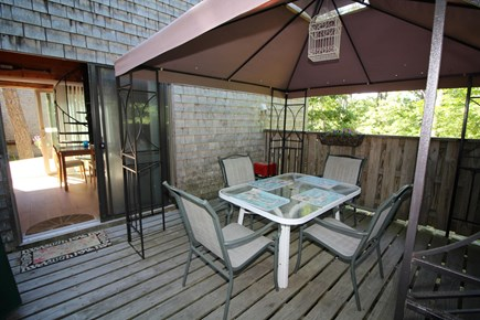 Wellfleet Cape Cod vacation rental - 14 x 20 deck with chaise lounge and outdoor dining.