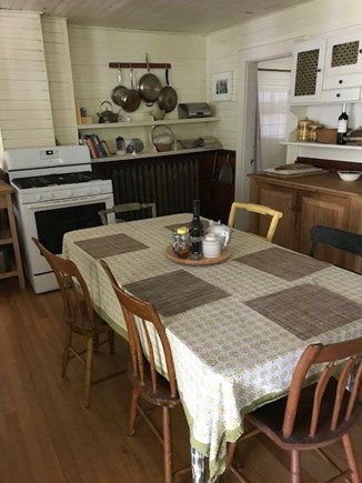 North Truro Cape Cod vacation rental - Kitchen, entered from porch; bathroom off kitchen to right