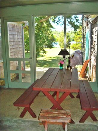 Brewster Cape Cod vacation rental - Screen porch with picnic table