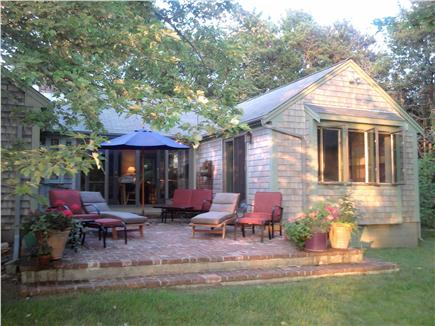 Brewster Cape Cod vacation rental - Private brick patio with water views of pond