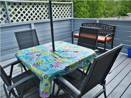 Dennisport Cape Cod vacation rental - Table w/ umbrella upper deck, Weber gas grill on lower patio