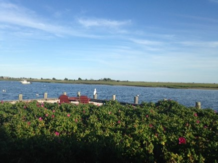 West Dennis Cape Cod vacation rental - Backyard sitting/fishing area on the water