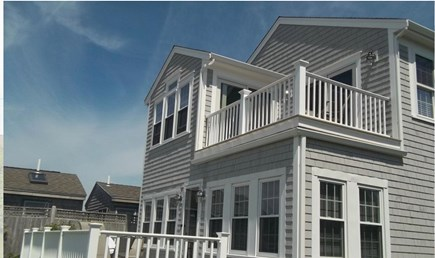 West Yarmouth Cape Cod vacation rental - Rear view of the home with relaxing decks and lovely ocean views.