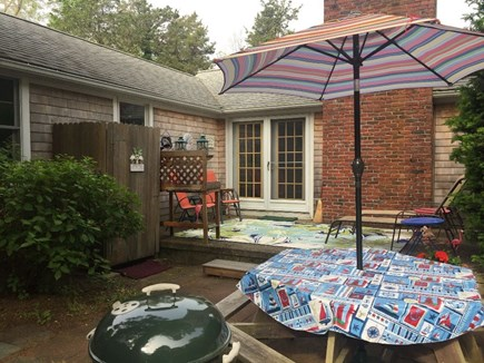 Eastham Cape Cod vacation rental - Private patio with enclosed shower on left, Weber charcoal grill