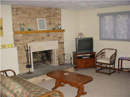 dennisport Cape Cod vacation rental - Lower level family room with stone fireplace