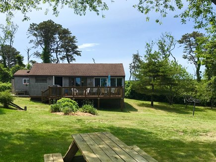 Brewster Cape Cod vacation rental - Front view of cottage w/full deck overlooking Paine's Creek & Bay