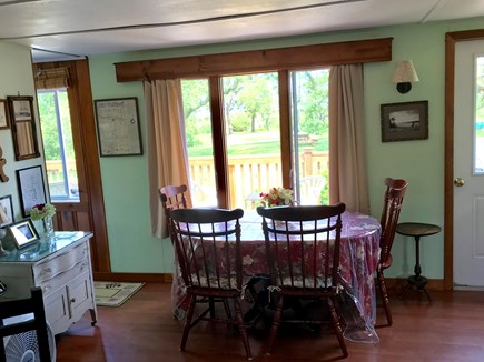 Brewster Cape Cod vacation rental - Dining area overlooking deck and bay.