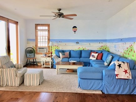 Dennis Cape Cod vacation rental - Living room with large sectional, full water views through slider