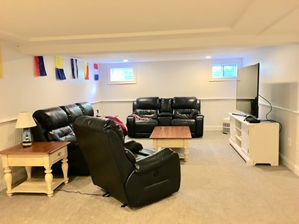Dennis Cape Cod vacation rental - Lower level man cave / media room with TV