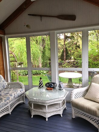 East Dennis - Sesuit Neck  Cape Cod vacation rental - Screened porch with comfortable wicker furniture