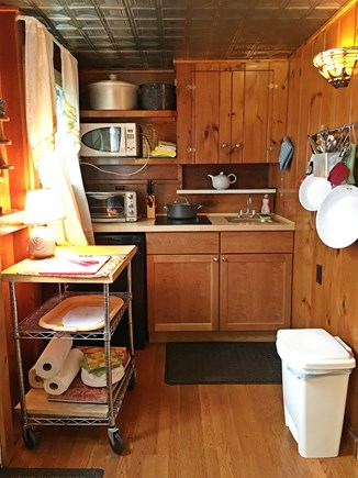 Eastham Cape Cod vacation rental - Renovated kitchen with Cook top, refrigerator, sink and more.