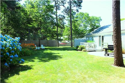 Yarmouth Cape Cod vacation rental - Backyard w/grill, hammock,patio w/ table & chairs