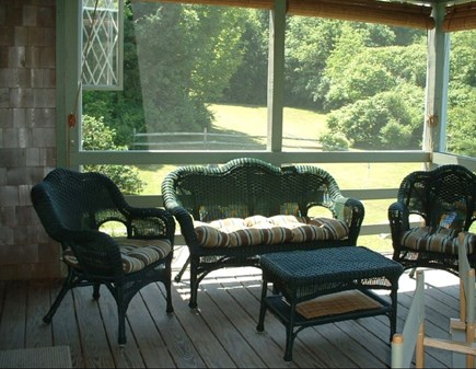 East Dennis Cape Cod vacation rental - Screened in porch sitting area