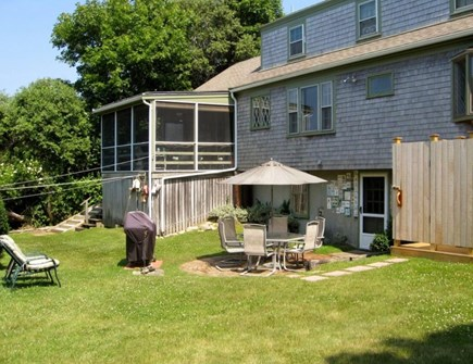 East Dennis Cape Cod vacation rental - Back yard with patio, grill and outdoor Hot/Cold shower