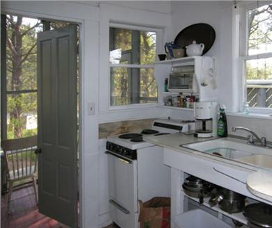 Wellfleet Cape Cod vacation rental - Kitchen looking toward screened in porch