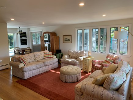 Eastham Cape Cod vacation rental - Living room with fireplace, panoramic window, lots of light.