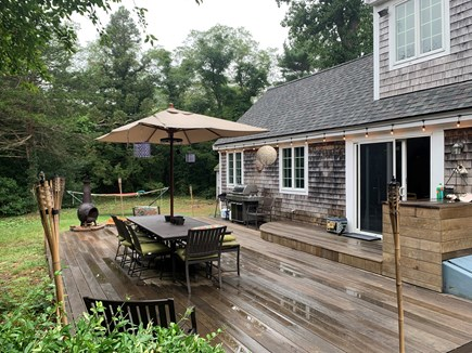 Eastham Cape Cod vacation rental - Large deck after some rain. A great gathering spot, rain or shine
