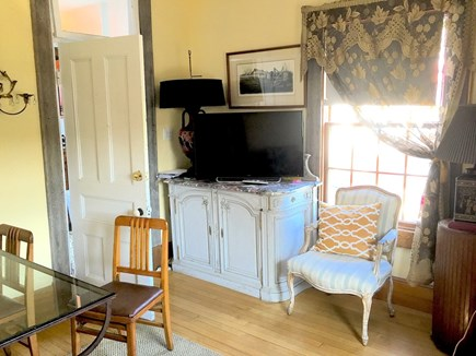 N. Truro Cape Cod vacation rental - Living/dining room with cable TV, glass table, and easy chairs