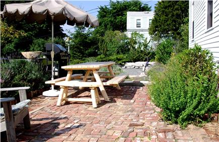 N. Truro Cape Cod vacation rental - Private brick patio with gas grill and adjustable table seating 8