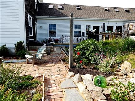N. Truro Cape Cod vacation rental - Brick pathway, past patio, up to apartment entrance door