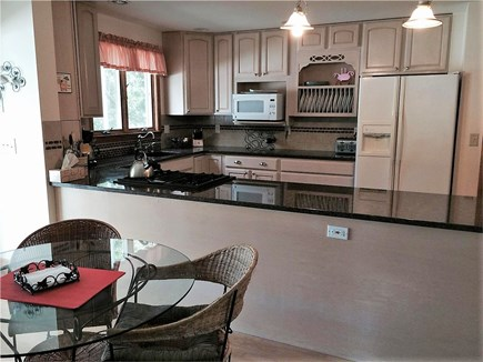 Eastham Cape Cod vacation rental - Enjoy a meal in the kitchen
