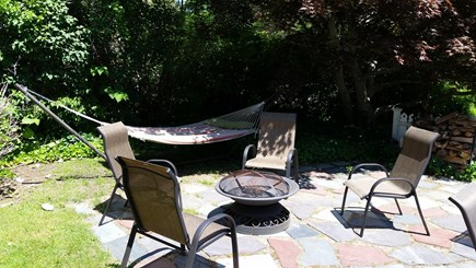 Chatham Cape Cod vacation rental - Patio with Fire Pit & Hammock