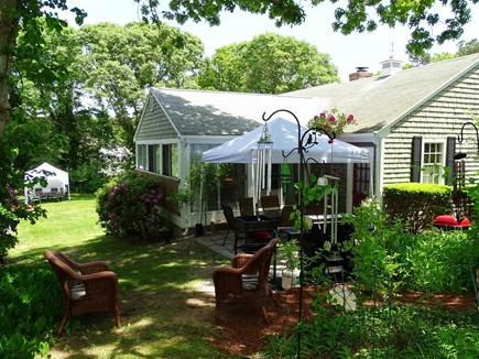 East Dennis Cape Cod vacation rental - Back patio with grills, dining table