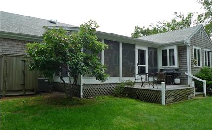 Harwich Cape Cod vacation rental - Lounge on the shady deck with grill and patio table