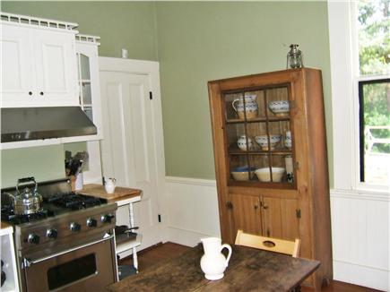 Yarmouthport Cape Cod vacation rental - Cozy kitchen with stainless steel appliances leads to deck