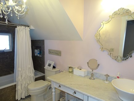 Dennis Port Cape Cod vacation rental - Dreamy bathroom with tub and chandelier