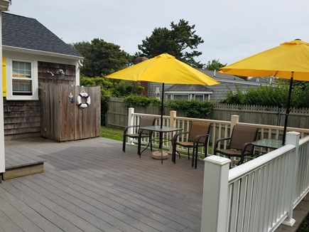 Dennisport Cape Cod vacation rental - Large fenced yard, grill and outdoor dining on the deck