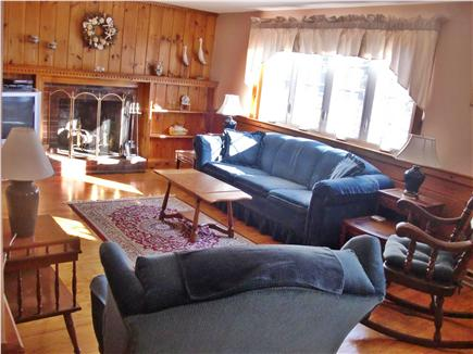Dennisport Cape Cod vacation rental - Large fireplaced living room with queen size sleep sofa