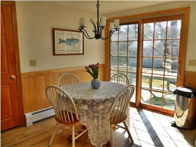 Harwich Cape Cod vacation rental - The dining area of the kitchen with French doors to the deck