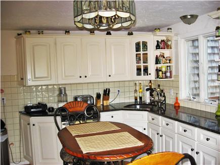 Harwich Port Cape Cod vacation rental - Kitchen has sliders to deck and grill