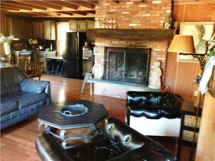 West Falmouth Cape Cod vacation rental - Fireplaced living area with view to kitchen