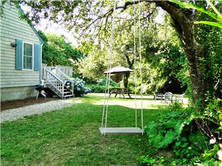 Brewster, Linnell Landing beach area, Br Cape Cod vacation rental - Side view; swing and eating areas for adults and kids