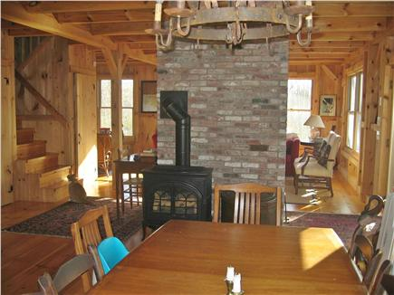 West Harwich Cape Cod vacation rental - Dining area with wood stove