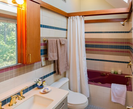 South Truro MA Cape Cod vacation rental - Upstairs bath features whirlpool tub, skylight, speakers