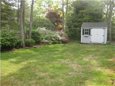Falmouth Cape Cod vacation rental - The backyard is large, private, and nicely landscaped.